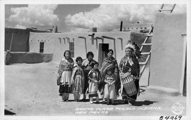 Pueblo Indians outside their New Mexico home
