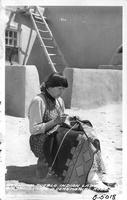 San Juan Pueblo Indian Lady embroidering a ceremonial Robe