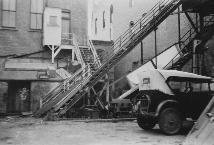 Demolishing the Grand Opera House, back side, on 203 E. 4th St. about 1930