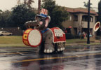 Elephant float, complete with Uncle Sam hat, moving up Broadway in the third annual Toys on Parade in Santa Ana, December 6, 1986