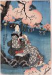 Woman seated beneath a cherry tree