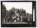 Scene In The Redwoods [Group of men, women, children, posing at a large redwood stump]