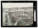 [Looking north over the Arcata Plaza with cars parked along H St.]