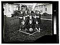 [Arcata High School girls in sport uniform with a ball and crutches]