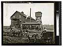 [Dairy scene, wagons and drivers in front of a work building]