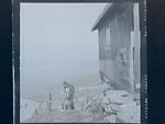 (D.L.'s family at seaside cabin)