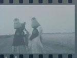 Women Carrying Jugs