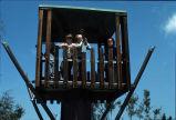 [Children on playground fort slide].