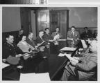 Photograph of staff meeting of City Housing Authority