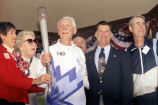 Dr. James Vernetti carries Olympic Torch to celebration in Spreckels Park, 2002.