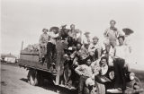 Guadalupe Produce Farm Workers : 1936 ; Tony Lapiz and sugar beet cutting crew with a truck load of sugar beets.