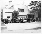 Upland Photograph Public Services; Upland Police Department: 11 officers standing by patrol cars in front of Upland Police Department
