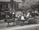"""The 1947 Cherry Festival Parade, a """"donkey"""" pulling the cart."""