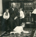 C. O. Barker and his three children; George, Omar Jr., and Carolyn in the parlor of their home on Murray Street in Banning, California
