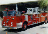 1969 Crown fire truck with 100' aerial ladder parked in front of fire station at 1001 Sixth Street.