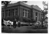 Upland Photograph Public Services; Upland Public Library (Carnegie) front lawn art exhibit