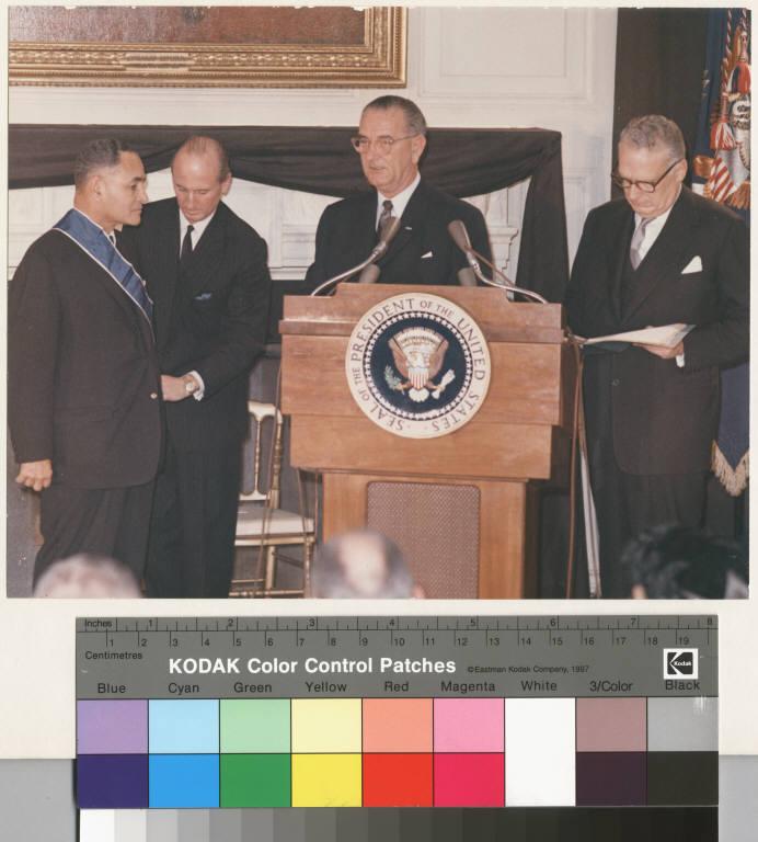 President Johnson awarding the Medal of Freedom to Ralph J. Bunche