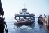 """The ferry boat """"Coronado"""" loaded with cars and passengers departs for its trip across the San Diego Bay, circa 1968"""