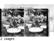 A Washerwoman And Group Of Filipinos, Manila, P.I.