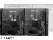 Open Hearth Furnace pouring Molten Metal into ladle.  Ford Motor Plant, Detroit, Mich.