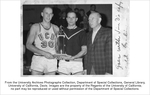 Basketball, men, Co-captains, Bill Story (left) and Mike Auman receive victor's trophy from Athletic Director Vern Hickey for winning the Far Western Conference title, the highlight of the Cal Aggies' 1966-1967 basketball season.