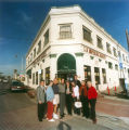 Photograph of members of the Placentia Historical Committee standing in front of the Kraemer Building.