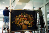 The Canasta de Flores mural by Alfredo Ramos Martinez being set into its steel frame support structure inside the Coronado Public Library, 2004