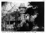 Photograph of house with round tower