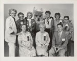 Photograph of eight women and one man with mascot Pioneer Pete