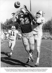 Football, Flanker back Dick South (22) trying for a pass against Nevada in a game at Toomey Field