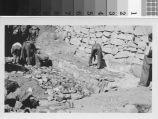 Laying masonry apron in front of large loose rock dam : Brand Park Project, Brand Park SP-30, Glendale, California, October 1935