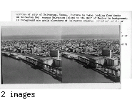 Airview of City of Galveston, Texas. Picture is taken looking from docks on Galveston Bay across Galveston Island to the Gulf of Mexico in background. In foreground are grain elevators of Galveston wharves, principal origin of greatest gulf grain export cargoes.  6/24/48 Copy supplies by Galveston Chamber of Commerce. Original print ret'd to owner 8/6/48.