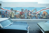 Large outdoor mural depicting working men
