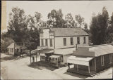 Buildings at the interaction of 5th Street and Egan Avenue in the 1890's. The Beaumont Post Office, the San Gorgonio Mercantile Company,and a pool hall are the three buildings pictured.