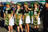 Four young women in costume for the Hmong New Year's Festival held in Banning, California