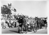 South San Francisco Bicentennial Parade - old time firemen, pulling wagon; horsedrawn wagon following (1958)