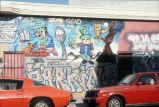 Mural and graffiti on a brick wall