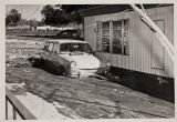 Car immersed in mud in Beaumont flood of 1969.