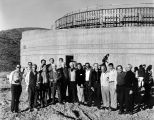 House of the Book under construction with board members posed in front