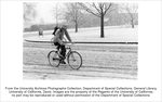 Snow on campus, bicyclist traveling north on California Avenue during snowfall