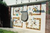 Facsimiles of Aztec calendar and four Quetzlcoatls, Math building, Citrus College, 1990