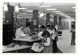 Library patrons and workers at the Central Library in Commerce