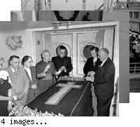 """Archbishop Hanna. Stateroom and afternoon on ship. SS PRES. MONROE.  Aug. 18 '47. A. Sponagel"" Funeral rites on deck and in cabin. On-deck service appears to be ritual following mass, and is attended by many clergy & large crowd, including photographers. Interior shots show small group around draped casket; priests are not wearing vestments for mass. Other shots show casket coming aboard. Not all negs are #'d. Unassigned."