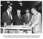 Phaff, Herman J., Professor of Food Technology, Jerome W. Rosen, Professor of Music, Herman J.                 Phaff, Professor of Food Technology, J. Richard Blanchard, Librarian, Chancellor Emil Mrak (left to                 right) examining the score composed by Darius Milhaud for the formal opening in 1961 of the assembly                 hall, Freeborn Hall.