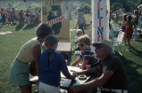 [State of Illinois welcome table at Fourth of July celebration, 1976 slide].