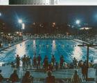 [Swim meet at nighttime photograph].