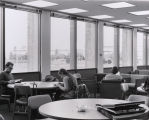 A photograph of students studying in the Library, likely on the Upper Mall on the Eastern side of the building.