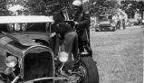 [Vintage cars and police officer on quad]