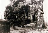 Mohawk Petroleum Fire with billowing smoke, wooden oil derricks