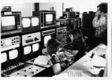 [Students and instructor in radio and tv lab]